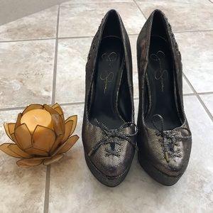 Jessica Simpson and gold/black metallic high heels